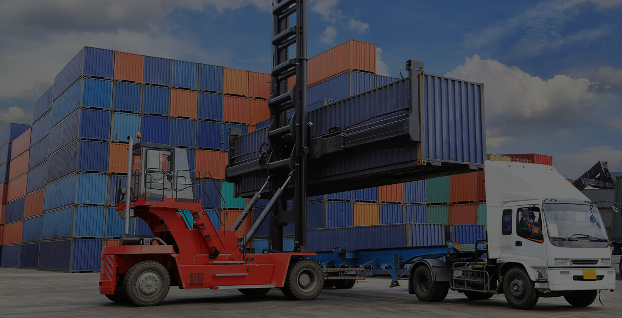 CBS Software - Depot Management Software, image of shipping container being loaded onto a truck.