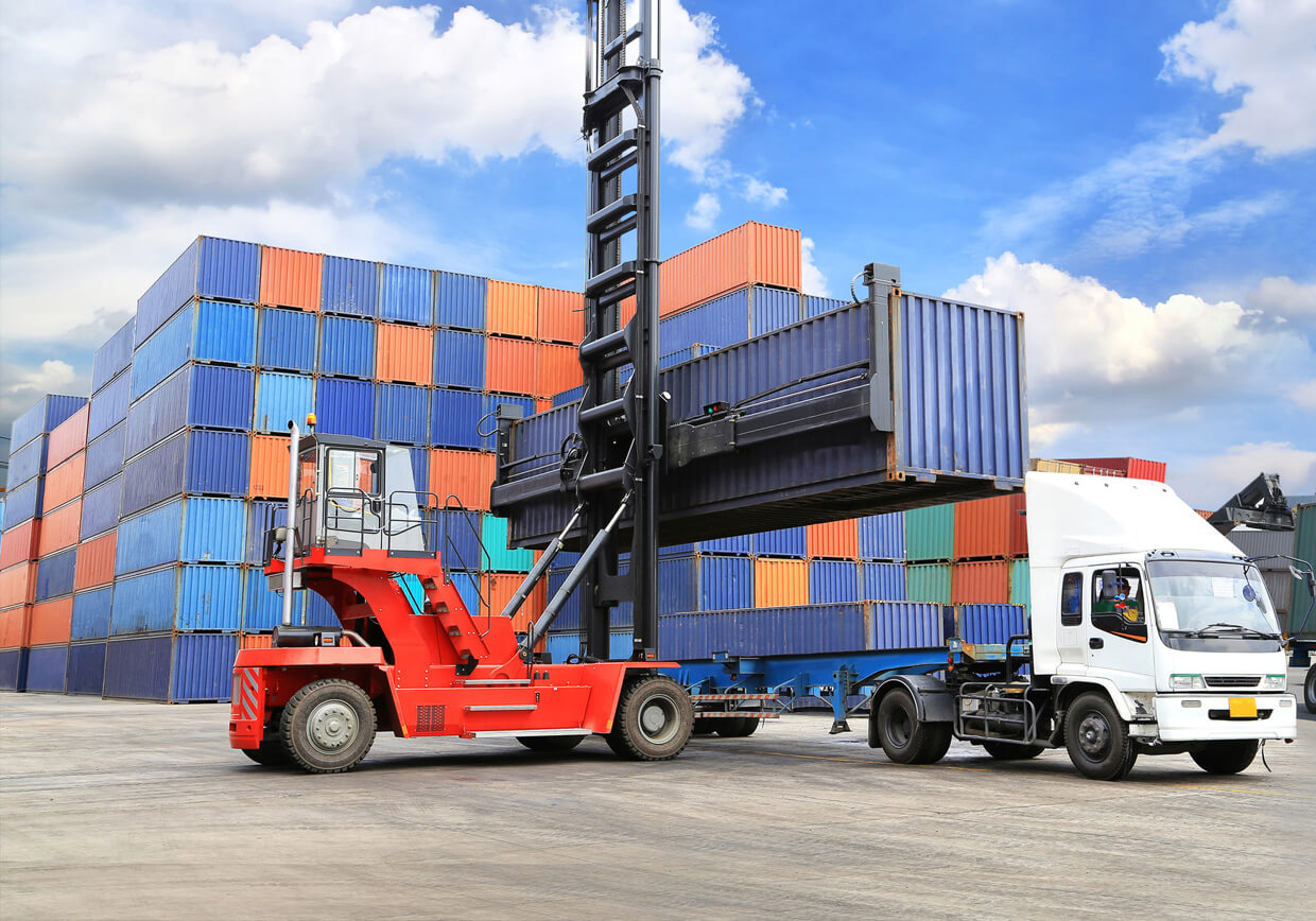 CBS Software - Custom Software Development Company image of shipping container being loaded onto a truck.
